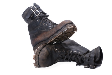 army boots: Pair of old mountain army boots  on white background Stock Photo