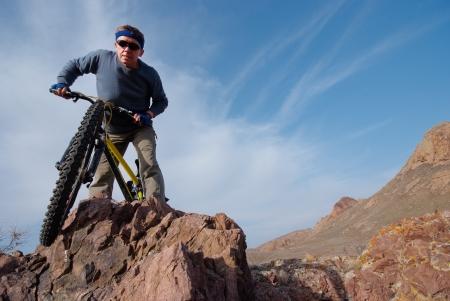 Bicyclist on background sky overcomes prepyatstvie  Horizontal frame Stock Photo