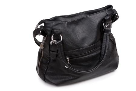 Feminine bag from natural skin on white background