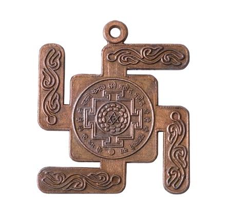 swastik: Copper medallion buddhist on white background