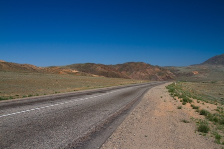 A beautiful winding country road through the hills  photo