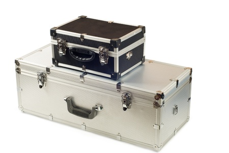 Two suitcases, aluminium and plastic on a white background photo