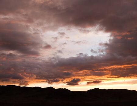 Silhouette of mountains against the beautiful sunset sky Stock Photo