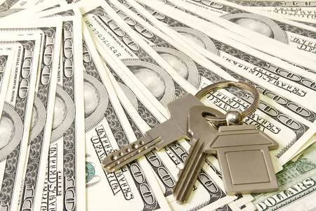 House keys over the hundred dollar banknotes  photo