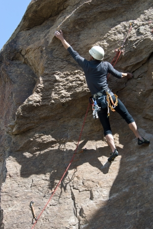 The rock-climber trains on a rock Stock Photo - 17963951