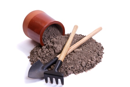 soil, tools and ceramic pot on a white background
