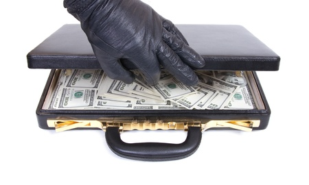 the hand in a glove opens a case with money photo