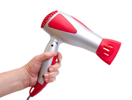 hand with the hair dryer on a white background Stock Photo