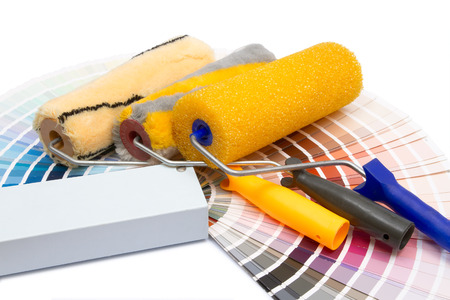 three painting rollers and album of colors on a white background Stock Photo