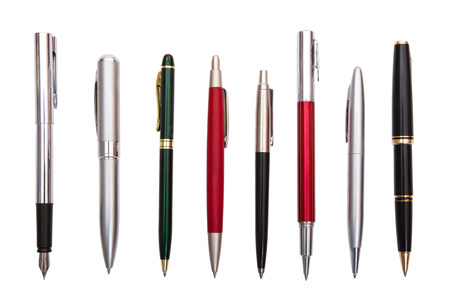 eight different pens on a white background Stock Photo