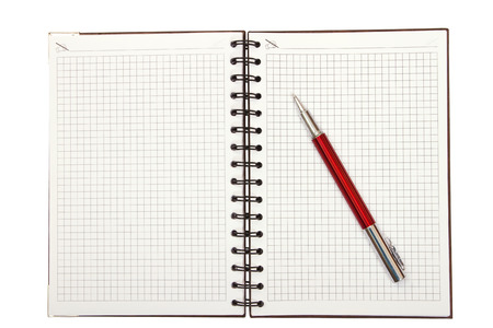 Notebook and red pen on a white background