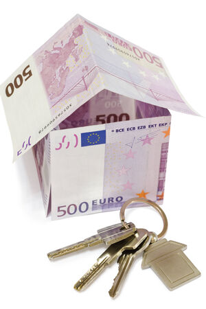 symbolic House of bank notes and keys on a white background