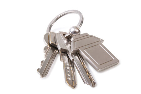 three key and keychain on a white background