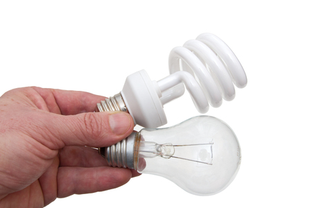 Hand with two electrobulbs on a white background