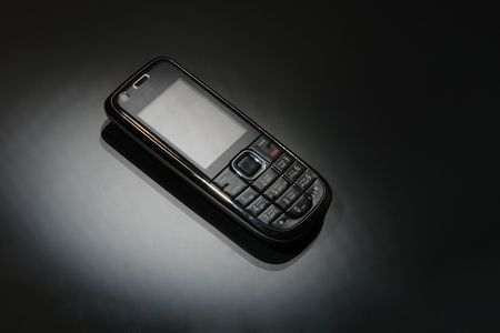mobile phone on a black Stock Photo - 6544378