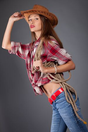 young woman in cowboy dress photo