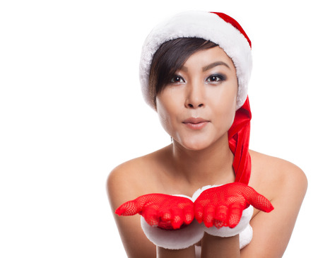 kissing lips: Portrait of beautiful Asian woman wearing Santa Claus with blowing kiss,christmas, winter,Human face expressions,emotions,isolated on white background.