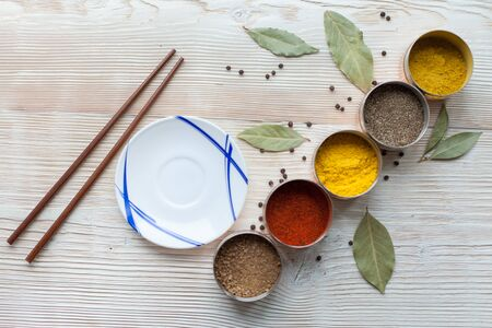 spices on a wooden light background photo Banco de Imagens