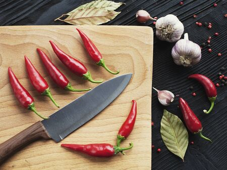 Knife chef  red chili pepper and spice on  wooden background