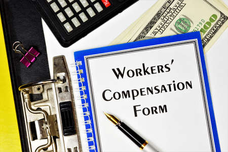 Workers' compensation form - text inscription on the form in the folder of the office Registrar. Monetary remuneration, depending on the qualification, complexity, quantity, and conditions. Фото со стока