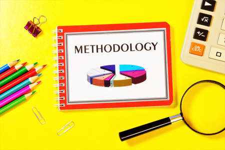 Methodology-writing the text in the research notebook. Teaching about strategies for studying the subject. Stock Photo