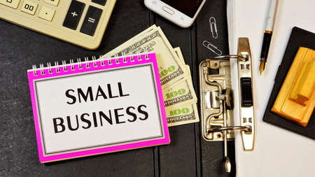 Small business is the inscription of text on the Notepad planning purposes. Strategy to achieve competitive advantage, search for new opportunities.