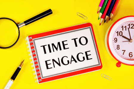 Time to engage - text inscription in Notepad. A forward-looking approach to planning and searching for new opportunities. Career growth, well-being.