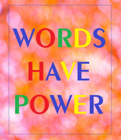 Words have power. Text inscription in the plate of the rainbow banner of the bright glare of bokeh lights. The word is the result of a thought process, sounds with feelings and emotions.