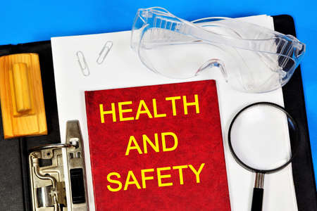 Health and safety - text label on the document folder of the office Registrar. Professional well-Being, labor protection, protection of employees' rights.