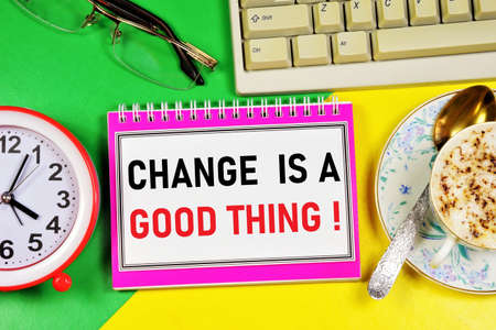 Change is a good thing. Text caption in the to-do planning Notepad. The clock is a symbol of time, a reminder of the past and the future. Overcome obstacles, set goals and work Stock Photo