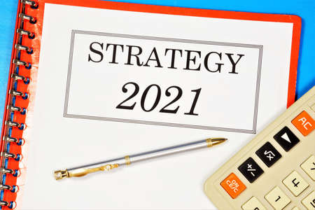 Strategy 2021 - text label in the planning folder. A promising approach for achieving a sustainable competitive advantage, searching for new opportunities in business and education.
