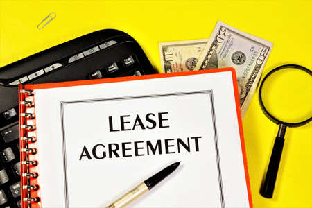 Lease agreement. Text label in the document form on the business planning folder. Form of property contract.