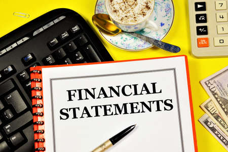 Financial statements. Text label in the form on the folder. Research of the accounting company's strategy and its expertise.