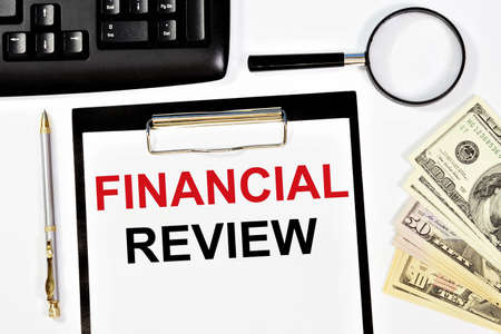 Financial review. Text label on the planning folder. Research of the accounting strategy of the enterprise and its expertise. Фото со стока