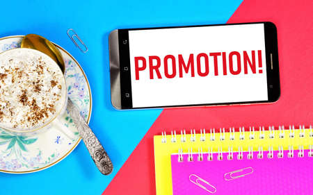 Promotion. The text label on the smartphone screen. The goal is to develop the brand, increase sales, attract potential customers, and make a profit.
