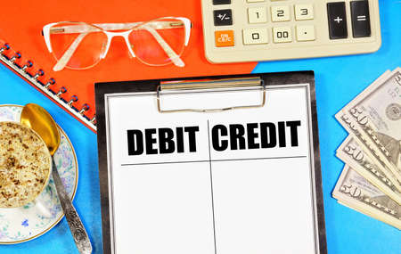 Debit and credit. Text label in the working document. Standard accounting methods. Stock Photo