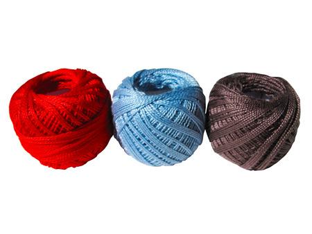 skein: Red, blue, brown thread skein, ball isolated on white background Stock Photo