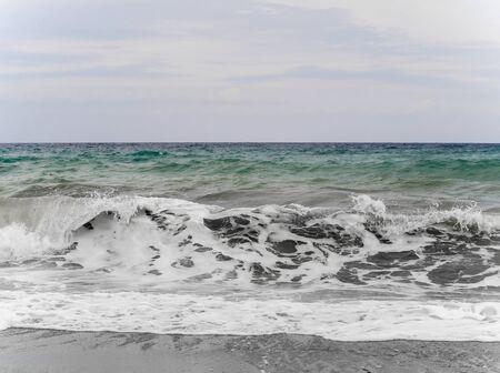 Big sea waves on the seashore