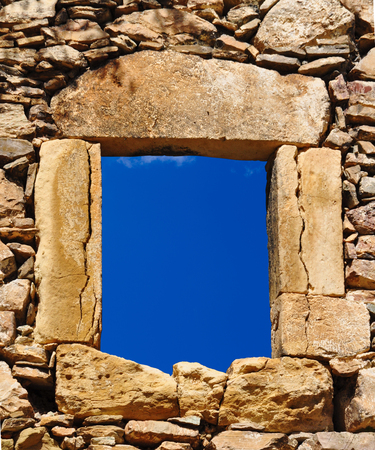 Traditional stone window and blue sky