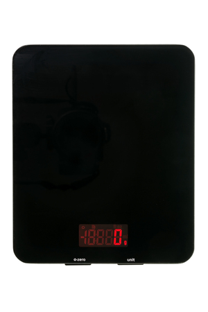 Black digital kitchen scale isolated over white