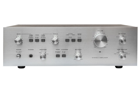Vintage stereo amplifier isolated over white