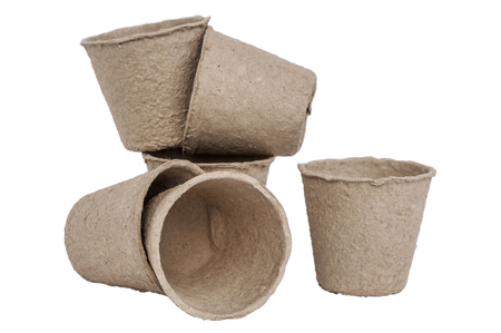 Peat moss pots isolated over white background