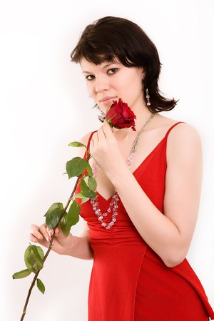 The girl in a red dress with a rose  photo