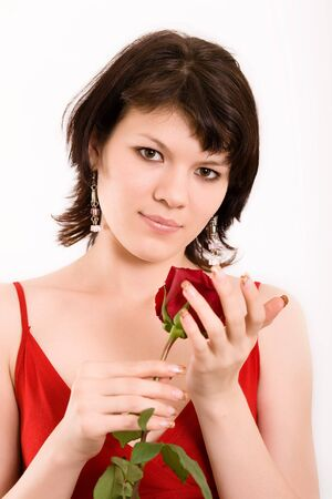 The Studio portrait of the beautiful girl with a rose  photo