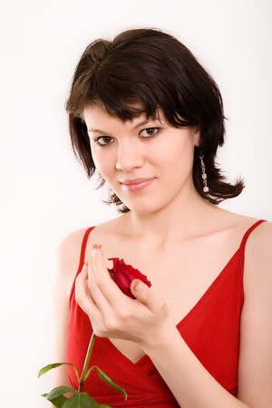 The Red rose in hands at the girl photo