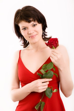 The Studio portrait of the beautiful girl with a rose