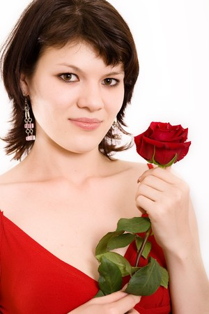 The Portrait of the girl with a rose in hands photo