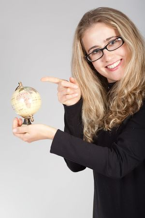 homestudy: The young emotional girl in points and with the globe in hands Stock Photo
