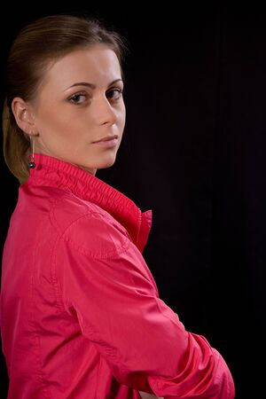 Portrait of the expressive girl in a red jacket on a black background Stock Photo - 6088888