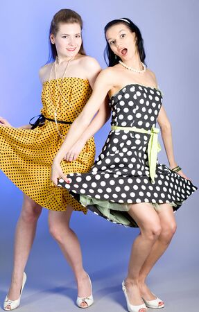 Two young beautiful girls in elegant dresses Stock Photo